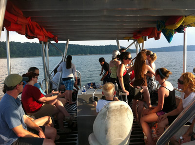 Enjoying the summer weather at the lab pontoon boat party.