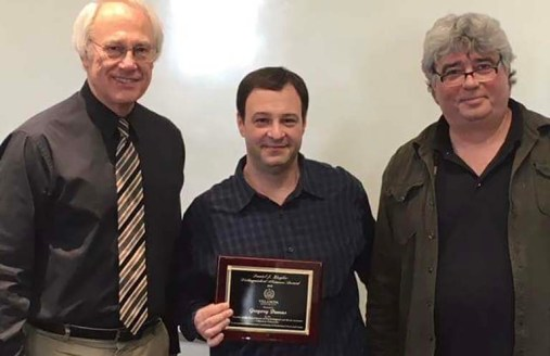 Greg receives the Daniel J. Ziegler Award from his alma mater, Villanova University.